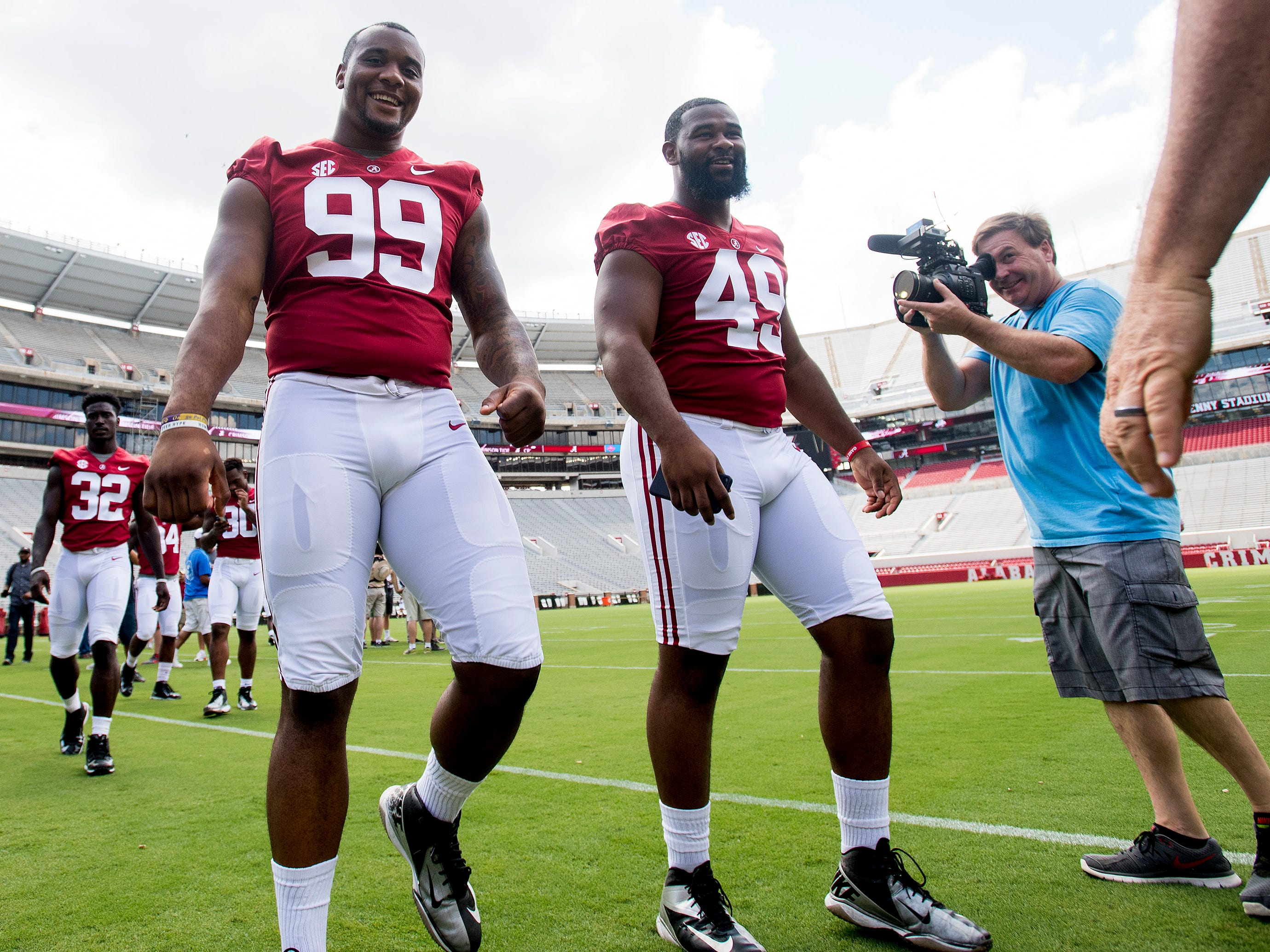 University of Alabama linemen Raekwon Davis (99) and Isaiah Buggs (49) before fan day on the Alabama campus in Tuscaloosa, Ala. on Saturday August 4, 2018.