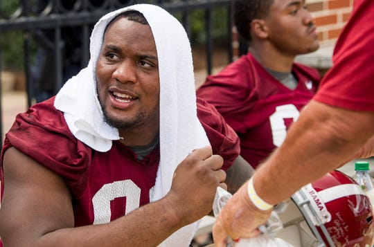 Lineman Raekwon Davis signs autographs during the University of Alabama football fan day at Bryant-Denny Stadium in Tuscaloosa, Ala. on Saturday August 4, 2018.
