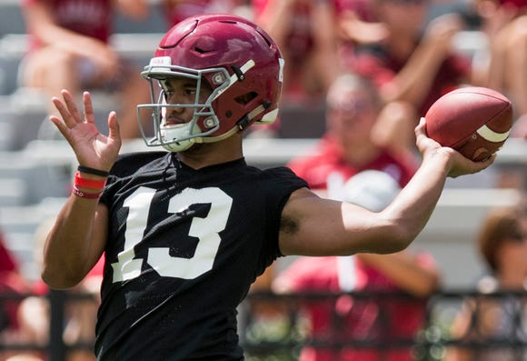Quarterback Tua Tagovailoa warms up as the University of Alabama football team holds practice in Bryant-Denny Stadium on the Alabama campus in Tuscaloosa, Ala. on Saturday August 4, 2018.