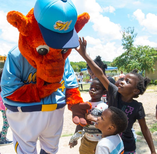 Montgomery Biscuits mascot Big Mo greets children.
