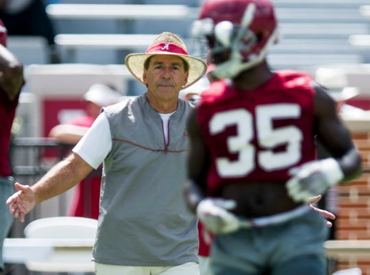 Head Coach Nick Saban coaches as the University of Alabama football team holds practice in Bryant-Denny Stadium on the Alabama campus in Tuscaloosa, Ala. on Saturday August 4, 2018.