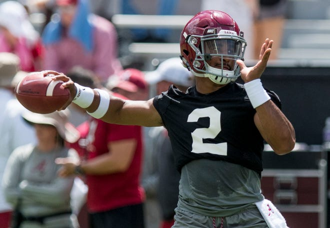 Quarterback Jalen Hurts throws as the University of Alabama football team holds practice in Bryant-Denny Stadium on the Alabama campus in Tuscaloosa, Ala. on Saturday August 4, 2018.