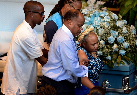 Vicki Hambrick mourns as she walks past the casket of her son, Daniel Hambrick, during the visitation service at First Baptist Church of South Inglewood on Saturday, August 4, 2018, in Nashville, Tenn. Hambrick was fatally shot by a Metro police officer on July 26 in Nashville.