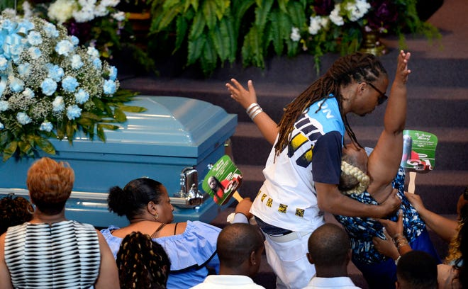 Vickie Hambrick, right, is comforted by a family member as she collapses during the funeral service for her son Daniel Hambrick at First Baptist Church of South Inglewood on Saturday, August 4, 2018, in Nashville, Tenn. Hambrick was fatally shot by a Metro police officer on July 26 in Nashville.