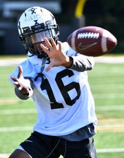 Kalija Lipscomb runs through a catching drill during Vanderbilt's first football practice of preseason camp