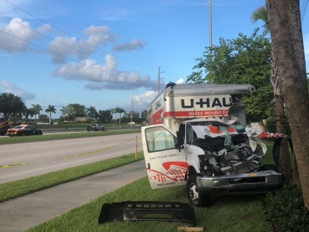 Florida Fish and WildlifeConservation Commission Officer Kyle Plussa was critically injured driving this U-Haul van when he was involved in a five-vehicle crash on Immokalee Road and Quarry Drive on Friday, Aug. 3, 2018, according to the Florida Highway Patrol. A 27-year-old Naples man died in the crash.