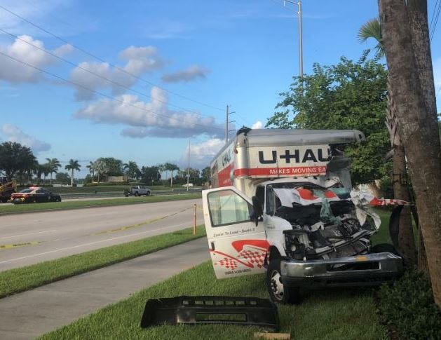 Florida Fish and Wildlife Conservation Commission Officer Kyle Plussa was critically injured driving this U-Haul van when he was involved in a five-vehicle crash on Immokalee Road and Quarry Drive on Friday, Aug. 3, 2018, according to the Florida Highway Patrol. A 27-year-old Naples man died in the crash.
