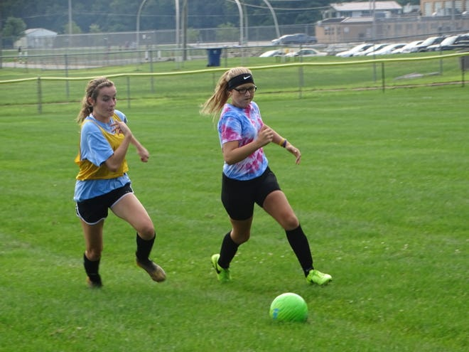 Watkins Memorial freshmen Mallory Spangler, left, and Chloe Morrison battle for possession this past Friday during an intrasquad scrimmage.