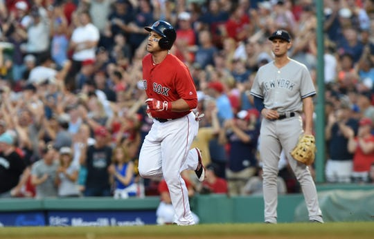 Aug 3, 2018; Boston, MA, USA; Boston Red Sox right fielder Steve Pearce (25) rounds the bases after hitting a home run during the first inning against the New York Yankees at Fenway Park.