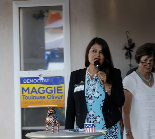 New Mexico Court of Appeals Democratic candidate Jacqueline Medina touts her legal experience Friday during a campaign event in Farmington.