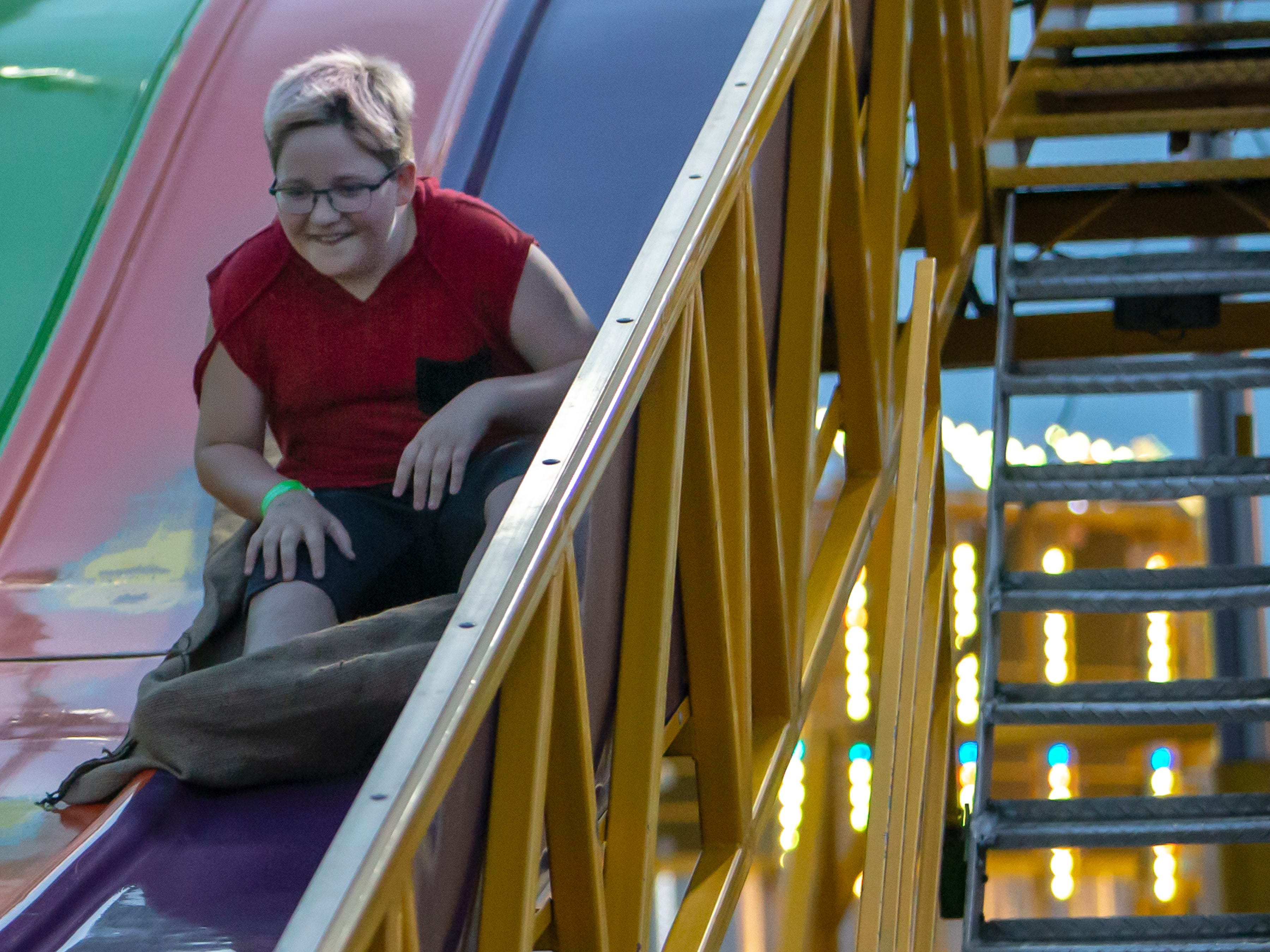 Zander Malson slides down the grant slide during the Winnebago County Fair on Friday, Aug. 3, 2018.