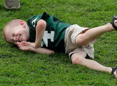 Rolling down Ariens Hill is the odds on favorite kid activity during Green Bay Packers Family Night  Saturday, August 4, 2018 at Lambeau Field in Green Bay, Wis.