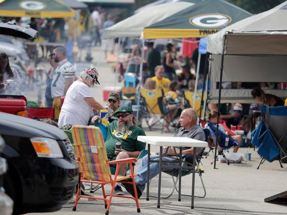 A very active tailgating scene in the hot weather before  Green Bay Packers Family Night Saturday, August 4, 2018 at Lambeau Field in Green Bay, Wis.