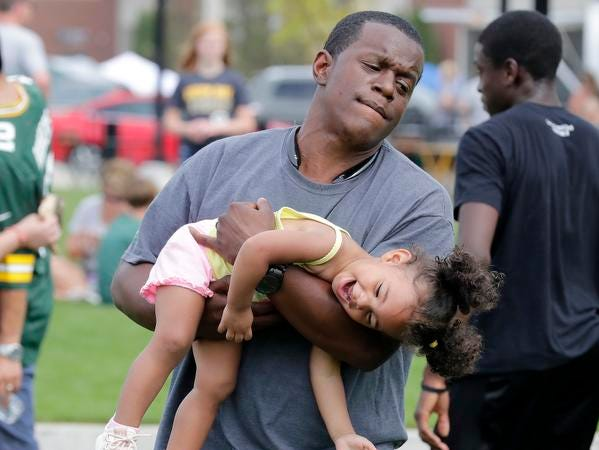 Jordan Roberson plays with his daughter Norah before the Green Bay Packers Family Night  Saturday, August 4, 2018 at Lambeau Field in Green Bay, Wis.