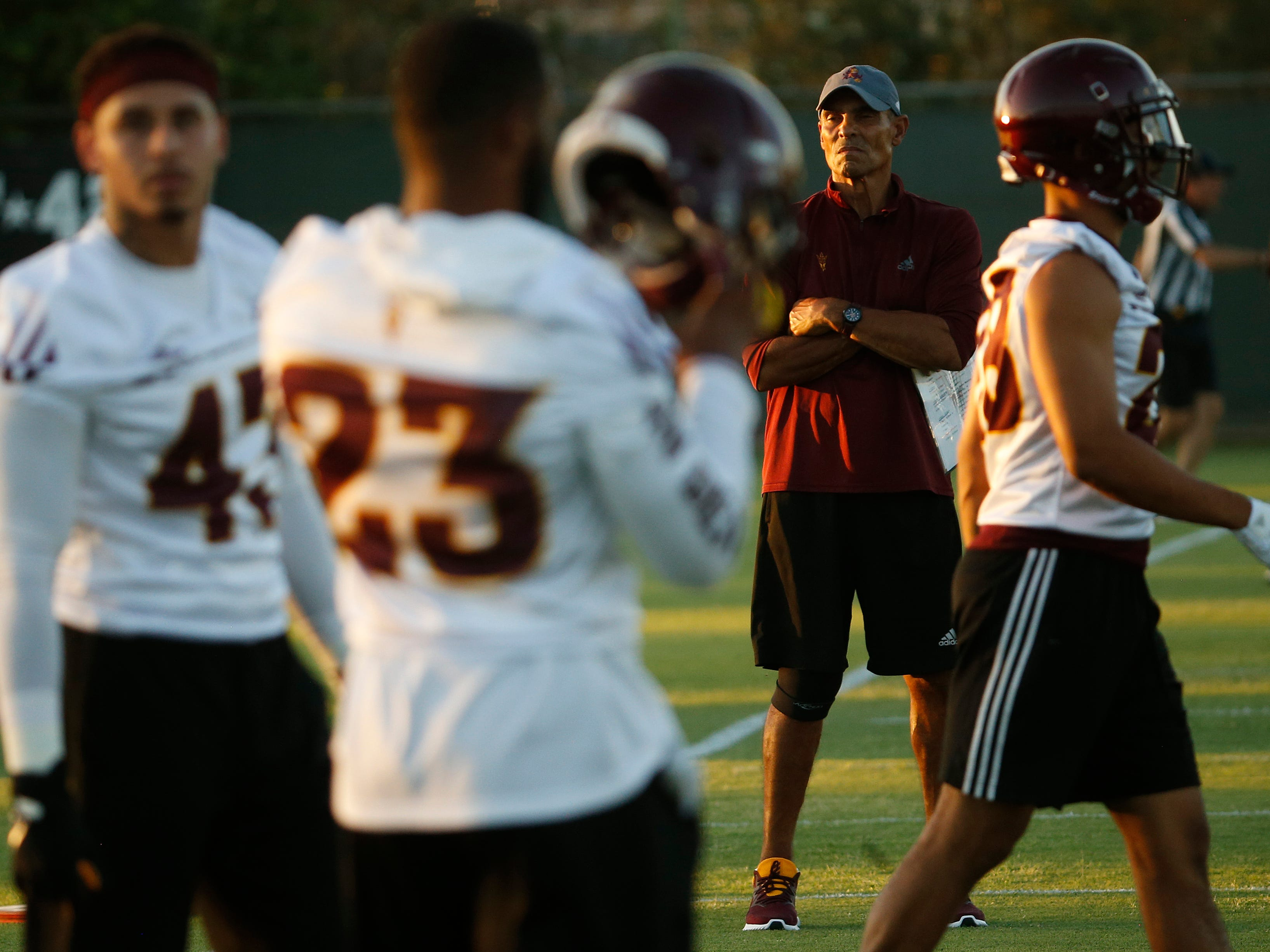 ASU head coach Herm Edwards watches his team during practice at Kajikawa Practice Fields in Tempe, Ariz. on Aug. 3, 2018.