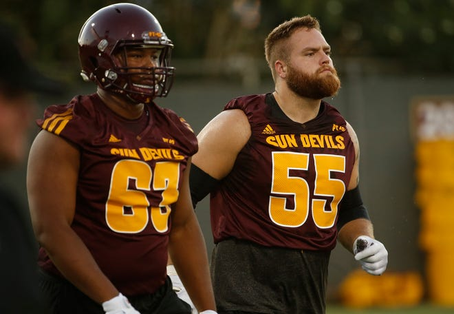 ASU's Roy Hemsley (63) and Casey Tucker (55) take the field during practice at Kajikawa Practice Fields in Tempe, Ariz. on Aug. 3, 2018.