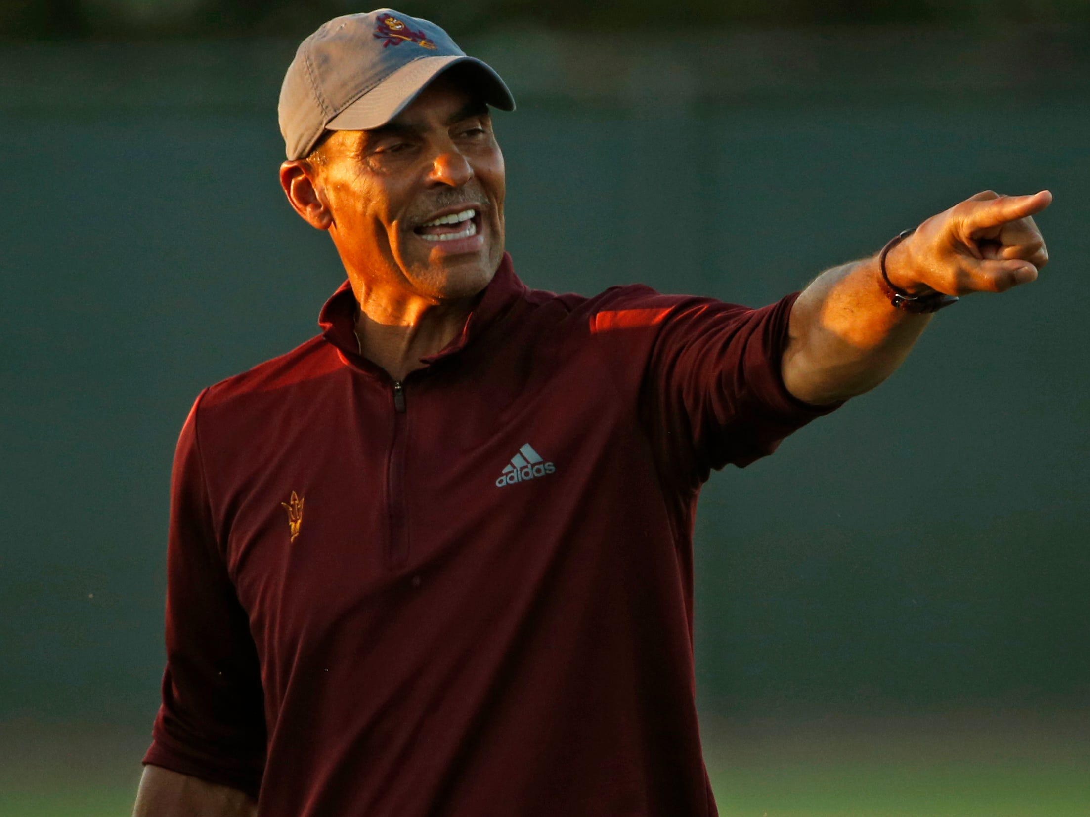 ASU head coach Herm Edwards instructs his team during practice at Kajikawa Practice Fields in Tempe, Ariz. on Aug. 3, 2018.