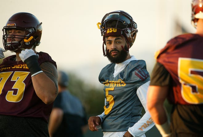 ASU's Manny Wilkins (5) runs drills with his team during practice at Kajikawa Practice Fields in Tempe, Ariz. on Aug. 3, 2018.