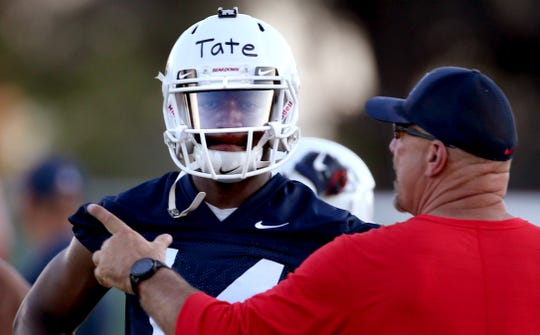 Quarterback Khalil Tate gets coached up a little by offensive coordinator Noel Mazzone at the first day of practice for the University of Arizona, Friday, August 3, 2018, Tucson, Ariz.