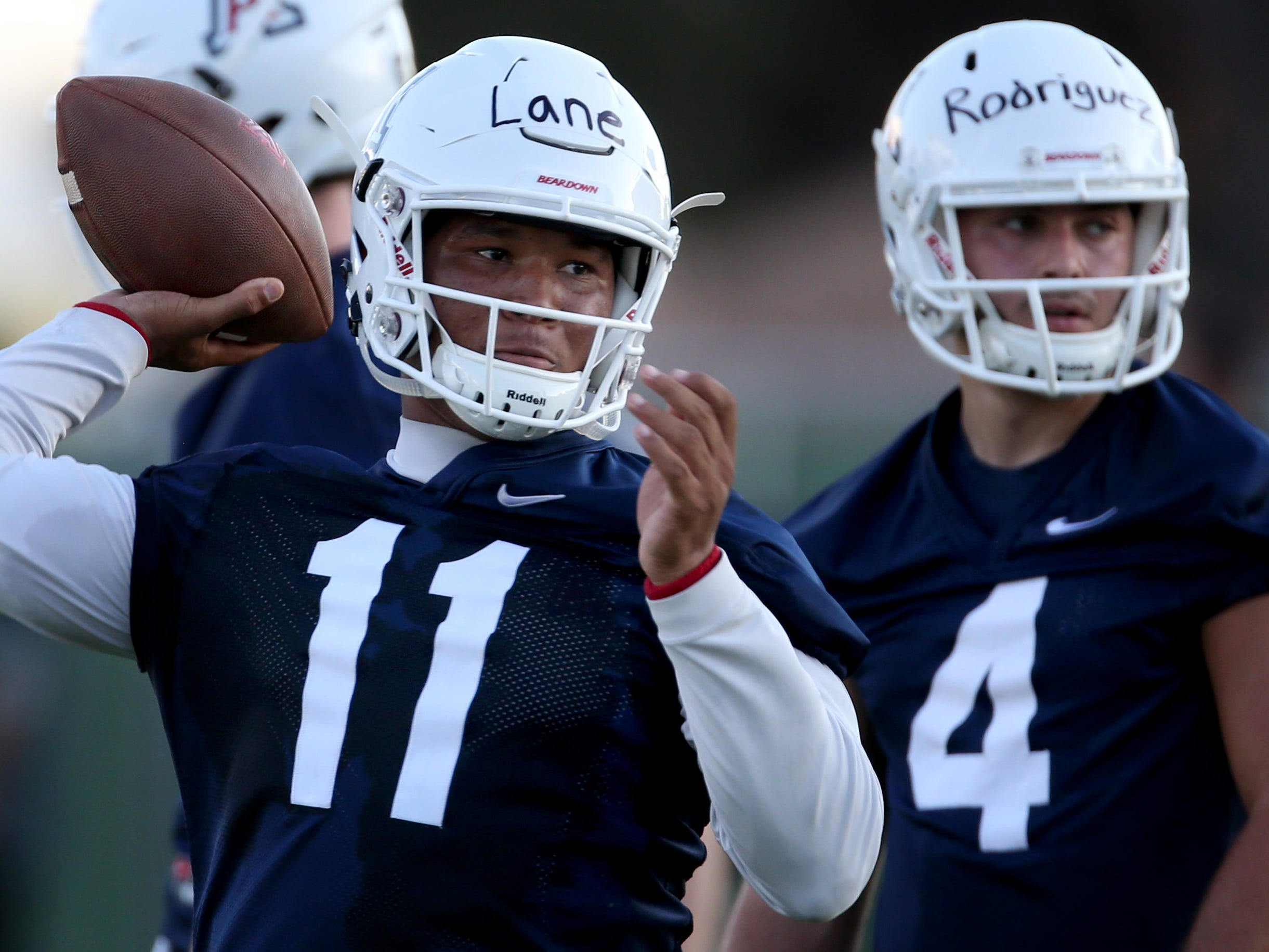 Wildcat quarterback K'Hari Lane draws a bead on a receiver while working out at the first day of practice for the University of Arizona, Friday, August 3, 2018, Tucson, Ariz.