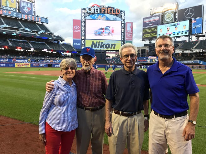 Diane O'Leary, Bob Ostertag, Tom Ostertag and Dan Ostertag pose at Citi Field on Thursday. Bob Ostertag threw out the ceremonial first pitch