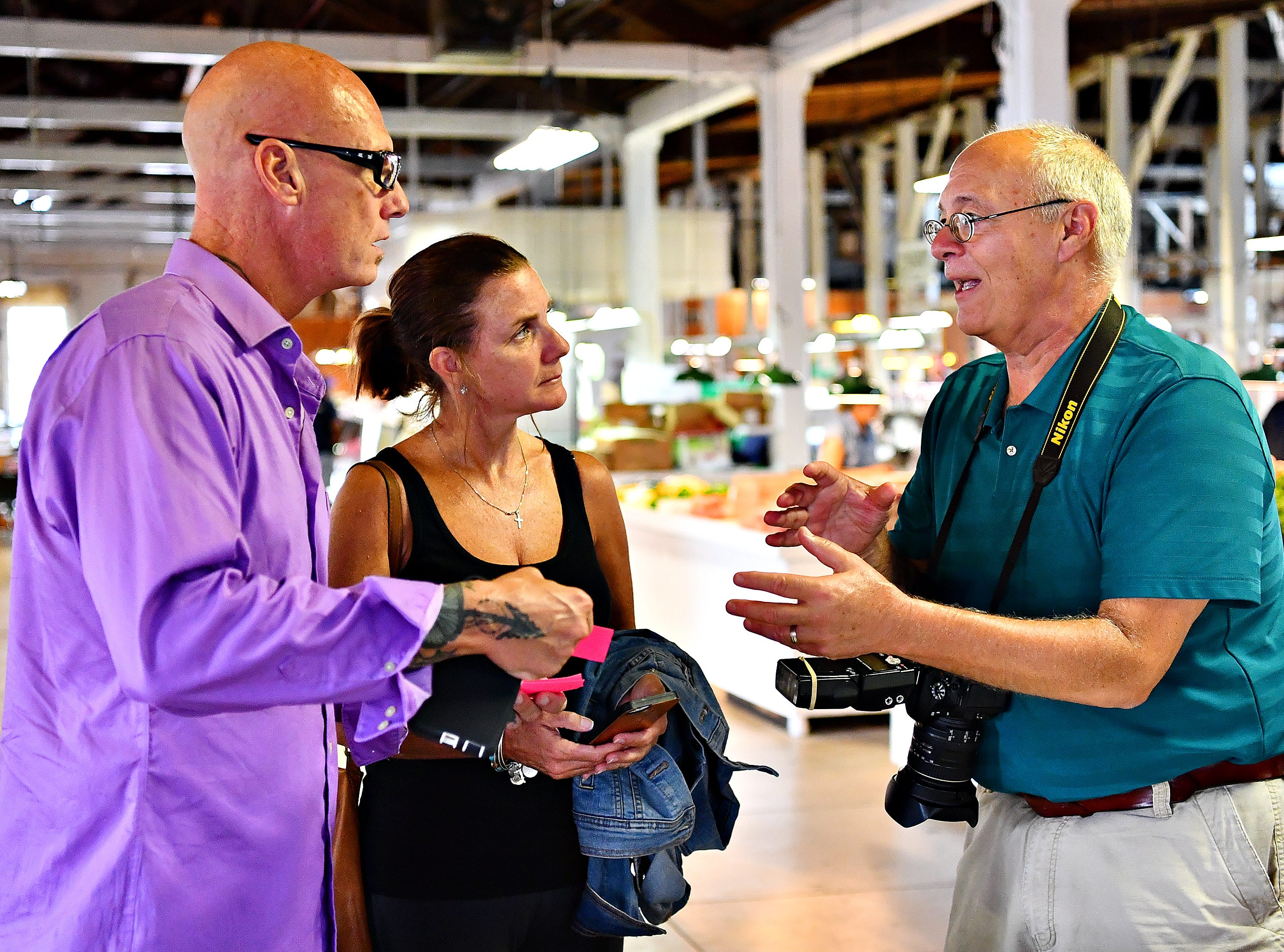 "From left, Tracy and Sher Young, of Spring Grove, talk to York Storyman Randy Flaum before being photographed for Author Anne Clark's, book of hope,""Messages of Hope from York!"" at Penn Market in York City, Saturday, Aug. 4, 2018.  Clark, the director of community outreach for Lincoln Charter School, says that after writing her own book, ""The Journey of Hope,"" she came to realize that the community of York needed its own book. Dawn J. Sagert"