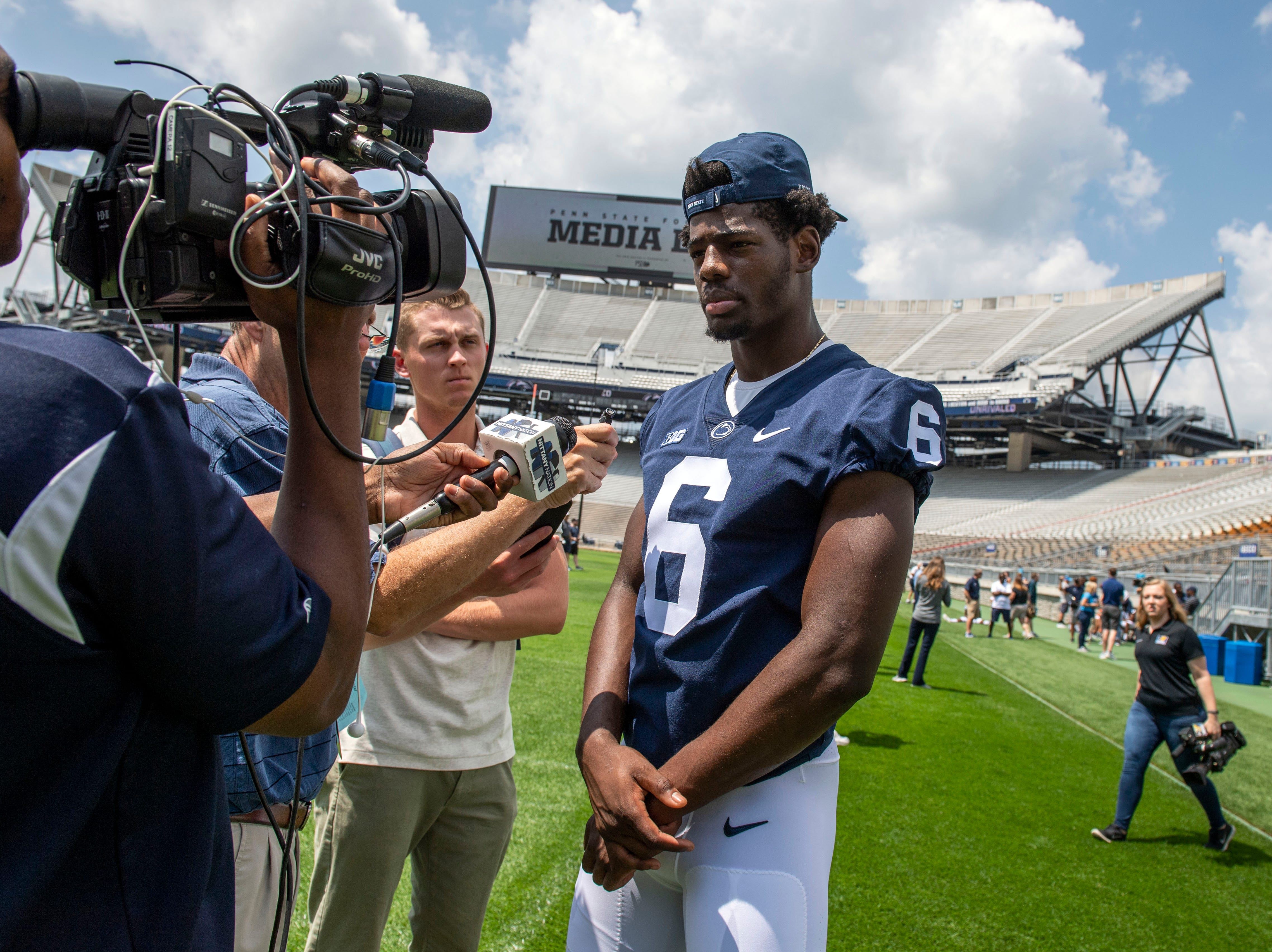 Line Backer Cam Brown speaks with reporters during media day at Beaver Stadium on Saturday, August 4, 2018.