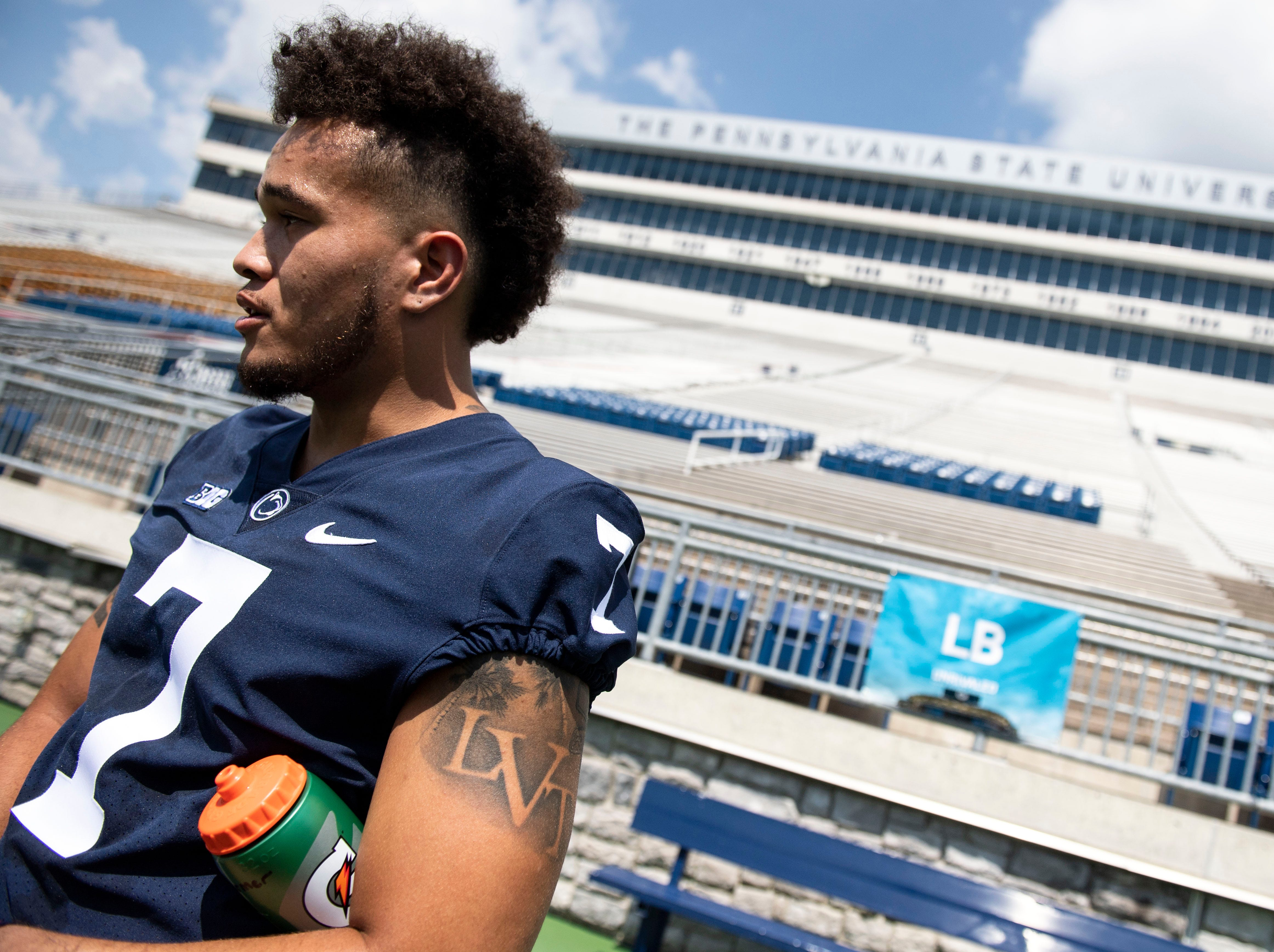 Line backer Koa Farmer speaks with reporters during media day at Beaver Stadium on Saturday, August 4, 2018.