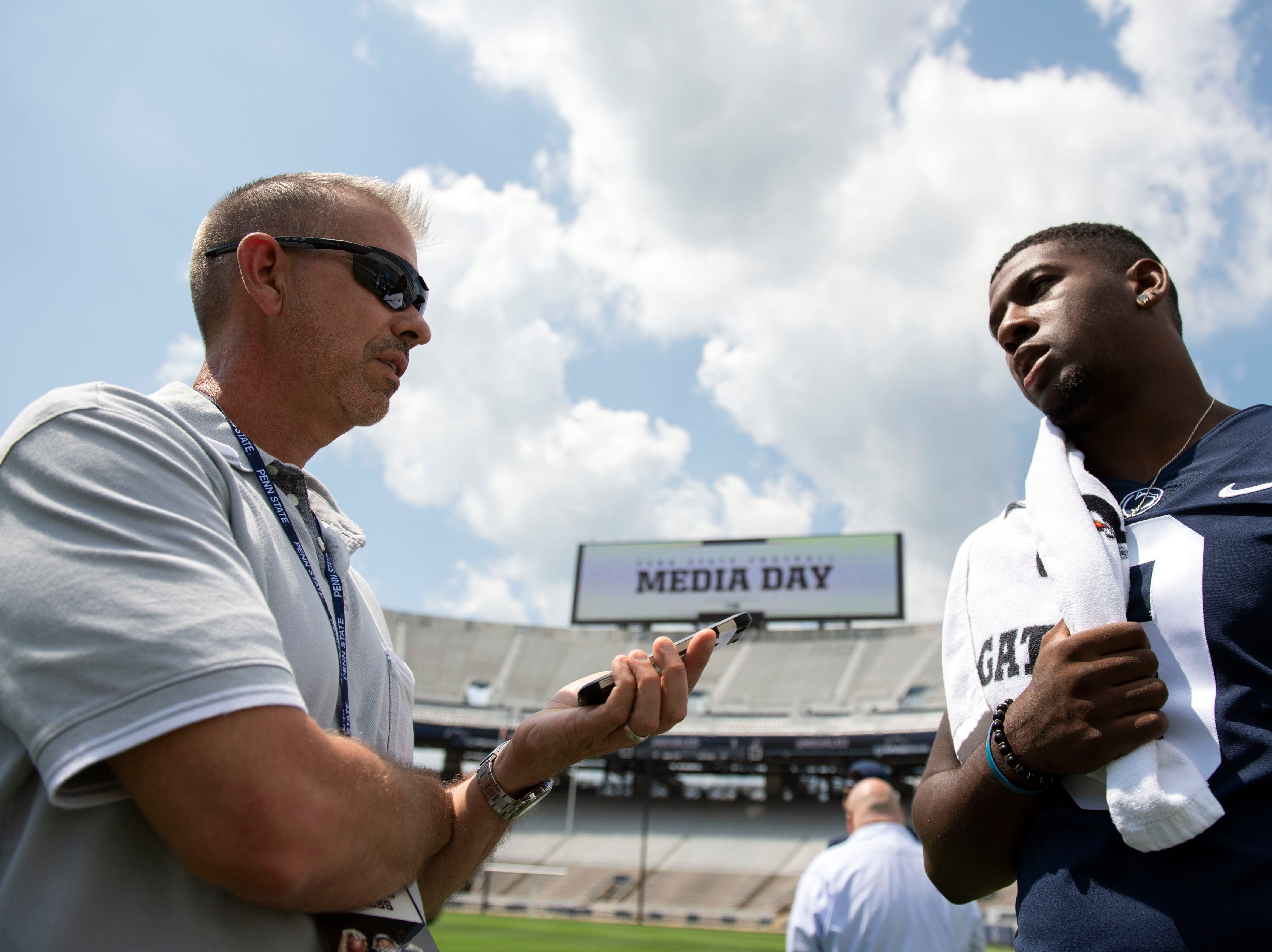 York Daily Record reporter Frank Bodani interviews line backer Jarvis Miller during media day at Beaver Stadium on Saturday, August 4, 2018.