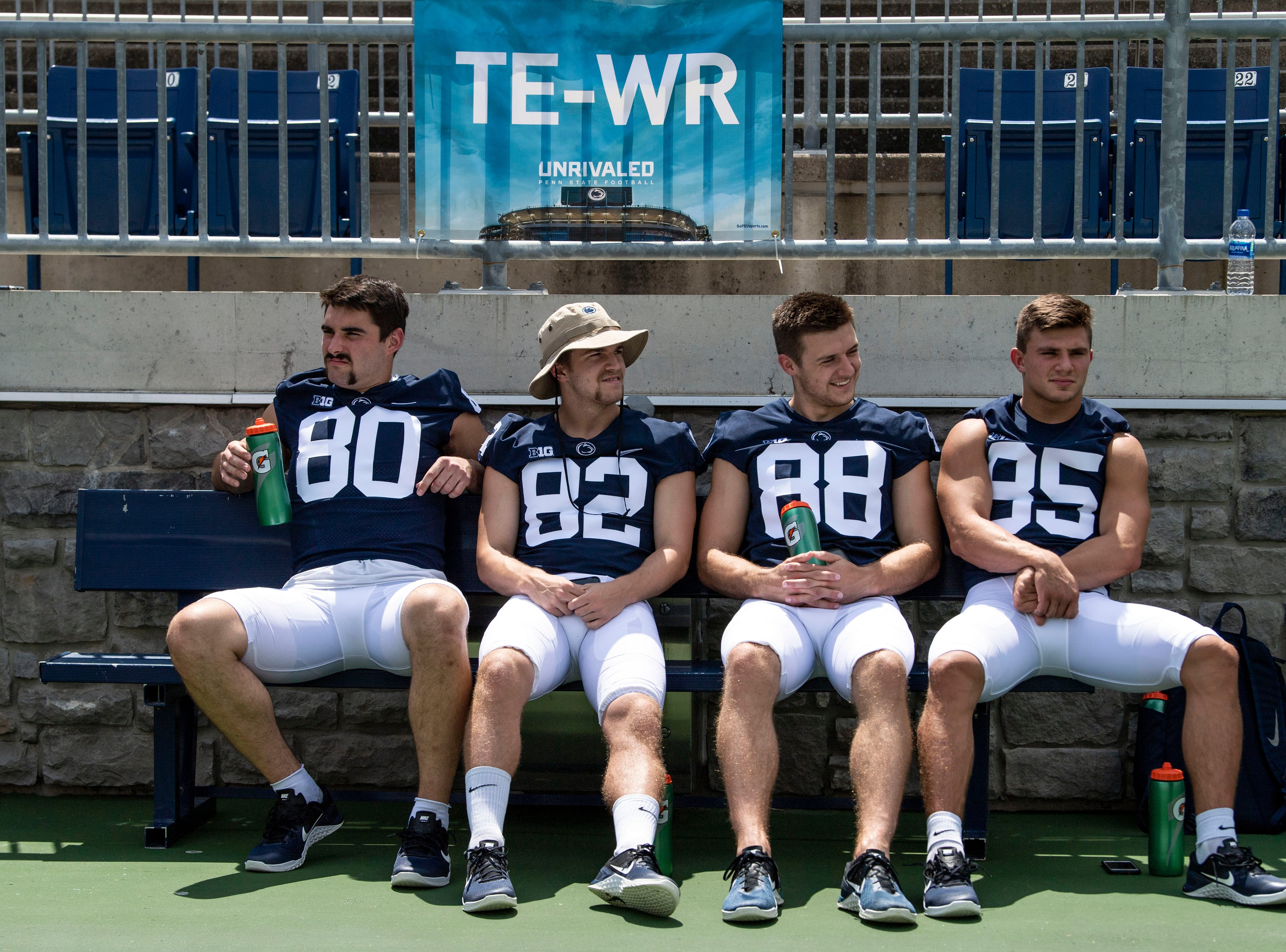Tightends and wide receivers sit on a bench waiting during media day at Beaver Stadium on Saturday, August 4, 2018.