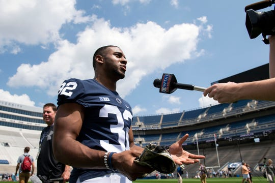 Running back Journey Brown speaks with a reporter during media day at Beaver Stadium on Saturday, August 4, 2018.