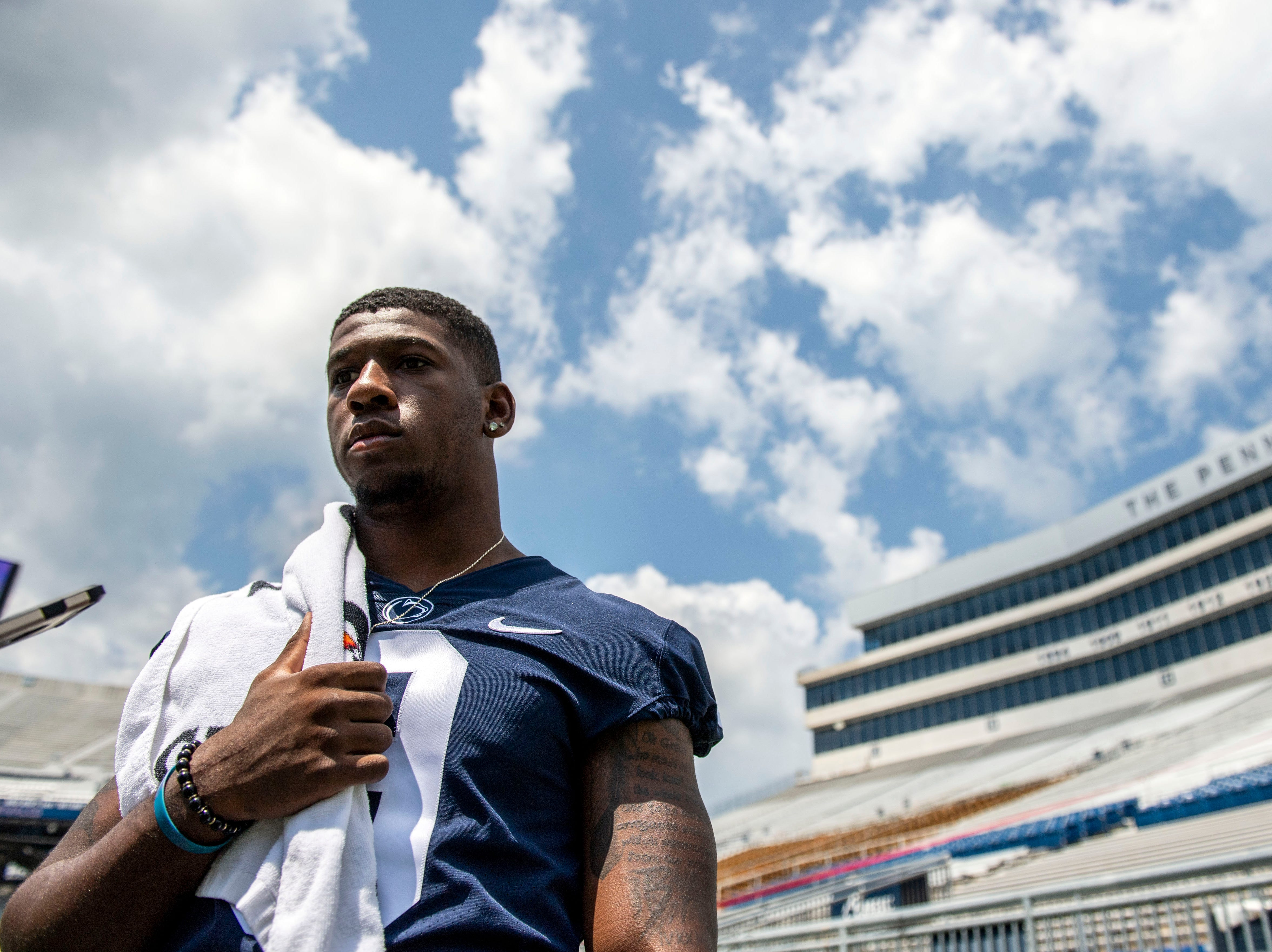 Penn State linebacker Jarvis Miller speaks with reporters on the field during media day at Beaver Stadium on Saturday, August 4, 2018.