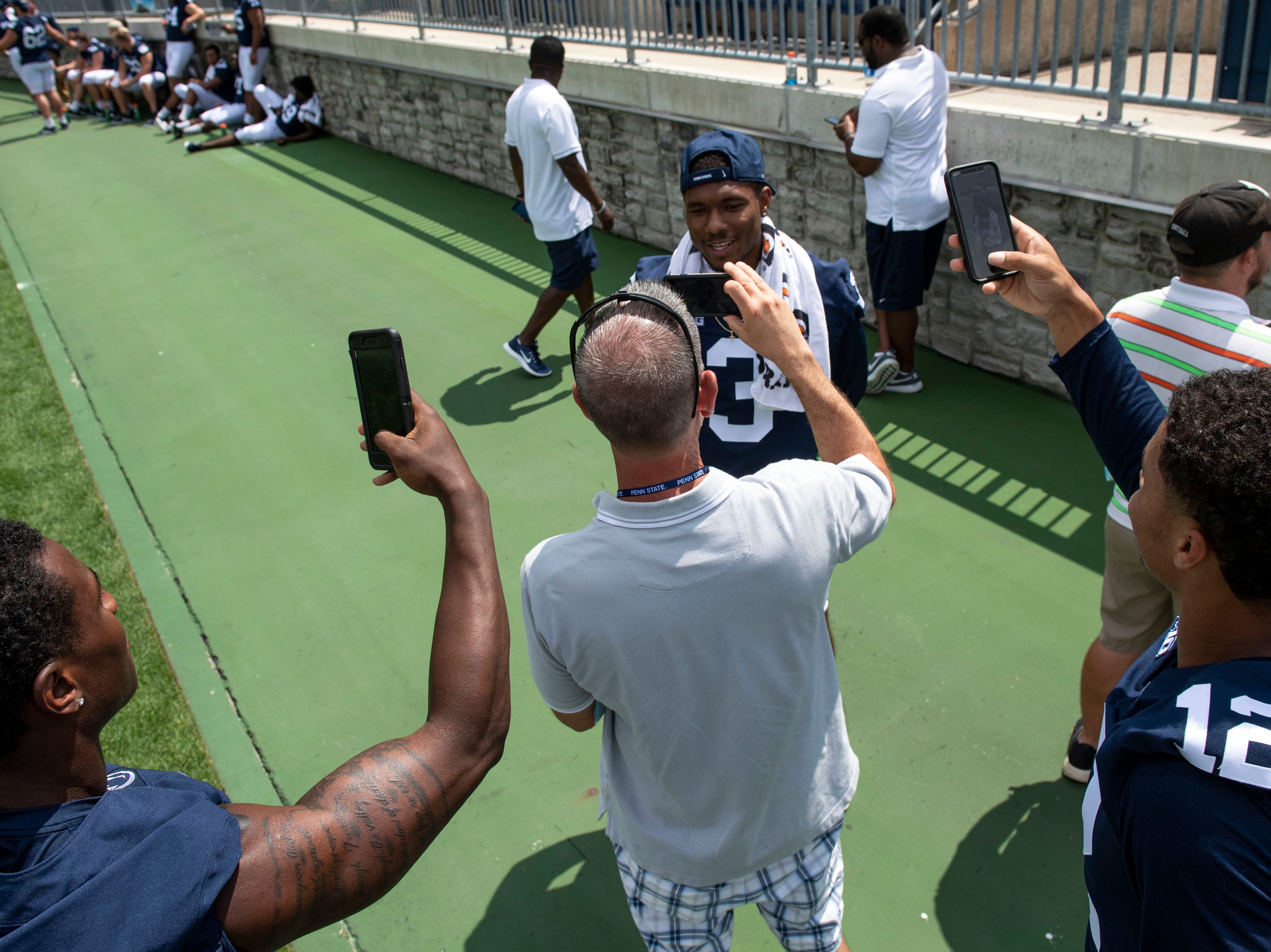 Penn State players joke around as York Daily Record reporter Frank Bodani interviews DeAndre Thompkins during media day at Beaver Stadium on Saturday, August 4, 2018.