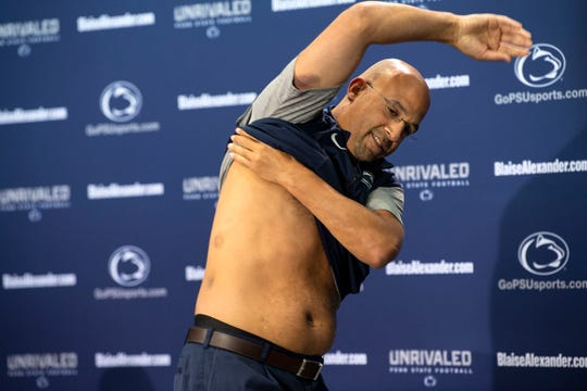 Penn State head coach James Franklin lifts his shirt to reveal welts from a recent players versus coaches paintball game at media day at Beaver Stadium on Saturday, August 4, 2018. 'Most of those shots came when I wasn't supposed to be getting hit,' Franklin said of the paintball game. 'Great idea on the front end. Not really good in terms of the execution of it.'