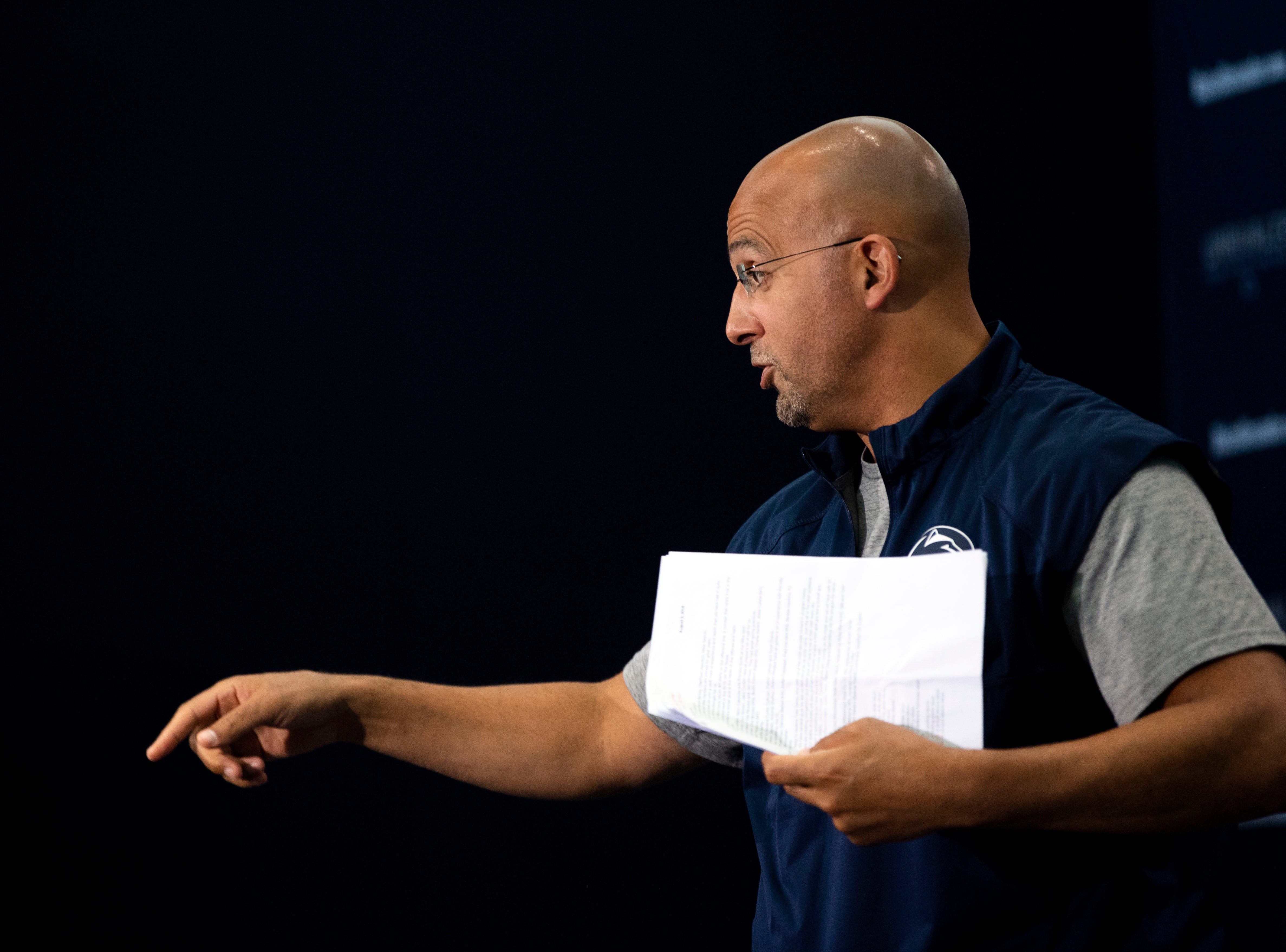 Penn State head coach James Franklin jokes with members of the media while exiting during media day at Beaver Stadium on Saturday, August 4, 2018.