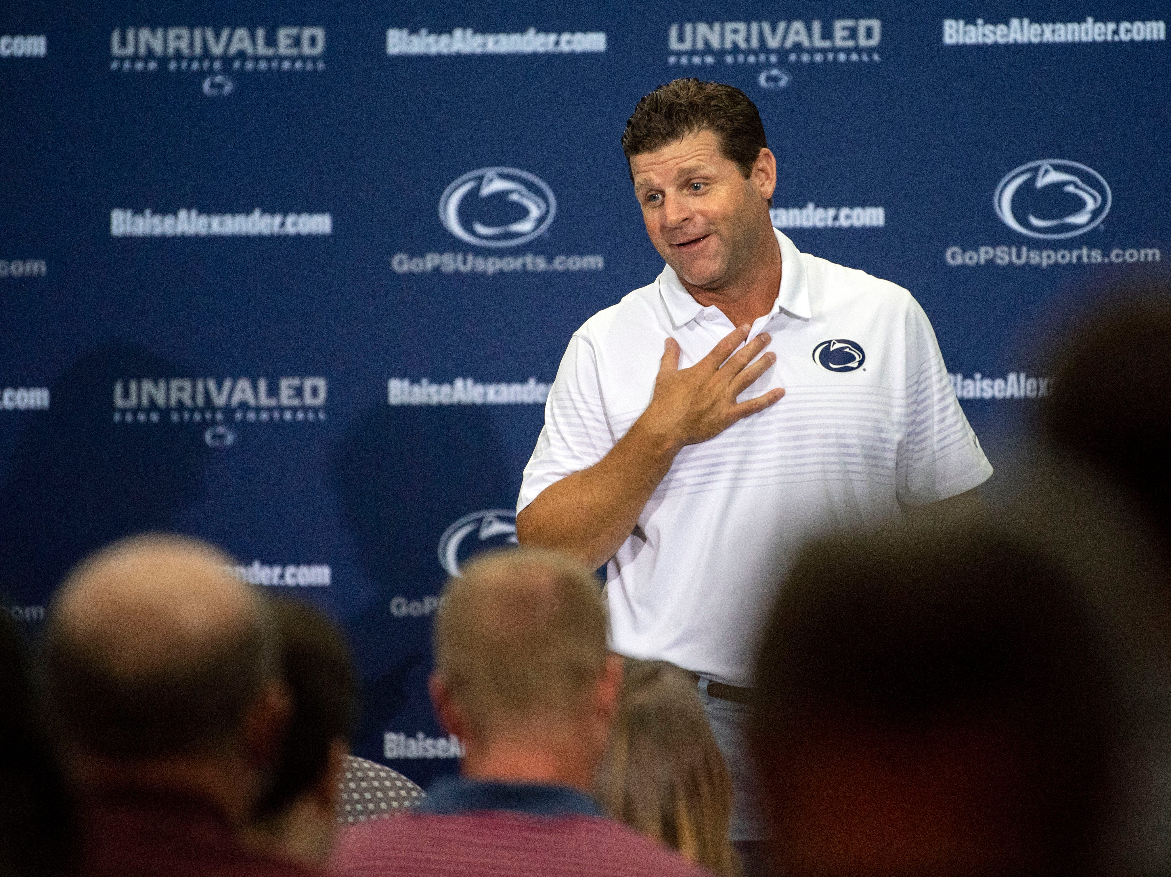 Penn State defensive coordinator and linebackers coach Brent Pry jokes about head coach James Franklin's bruises from a recent players versus coaches paintball game during media day at Beaver Stadium on Saturday, August 4, 2018.