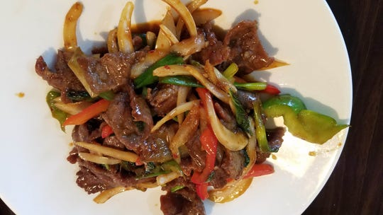 The pahd bai ga paw spicy basil with beef dish is one of many dishes cooked at Shui Asian Fusion restaurant on University Avenue in Rochester.