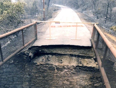 The Carr Fire wrecked this bridge on the Sacramento River Trail by burning wooden beams underneath the path. Four bridges on the trail were destroyed and a 6-mile section remains closed.