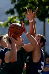 Tony Wilson, of Chafing the Dream, shoots past QQ Properties' Jacob Haqq in the Hoopla 3x3 basketball tournament near the Oregon State Capitol in Salem on Saturday, Aug. 4, 2018.