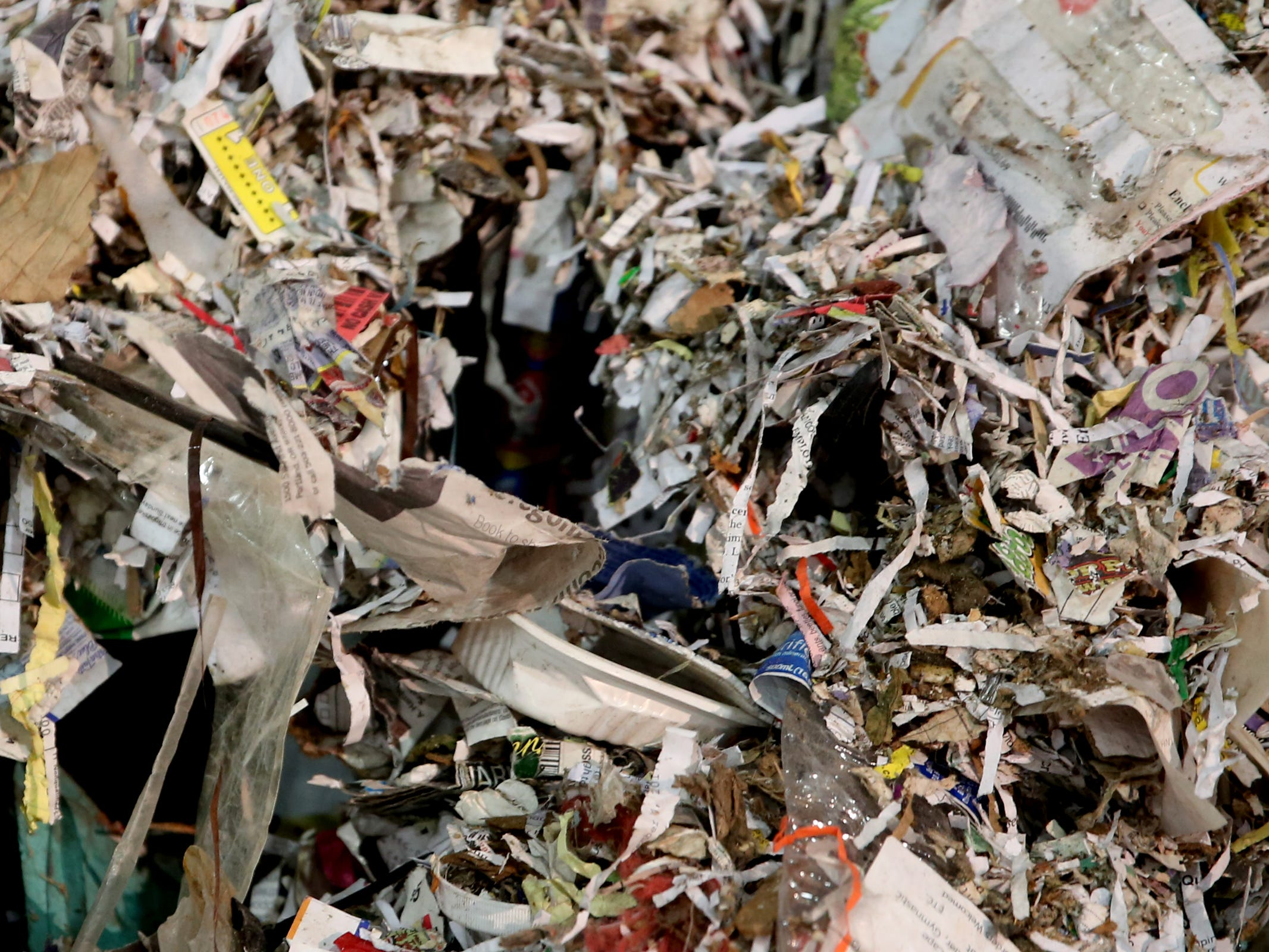 Trash that cannot be recycled or sold, like shredded paper, piles up at Garten Recycling in Salem on Friday, Aug. 3, 2018.