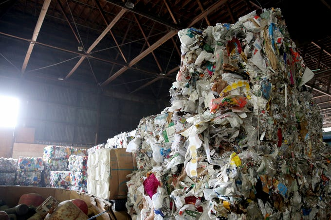 Trash that cannot be recycled or sold is baled to be sent to a landfill at Garten Recycling in Salem on Friday, Aug. 3, 2018.