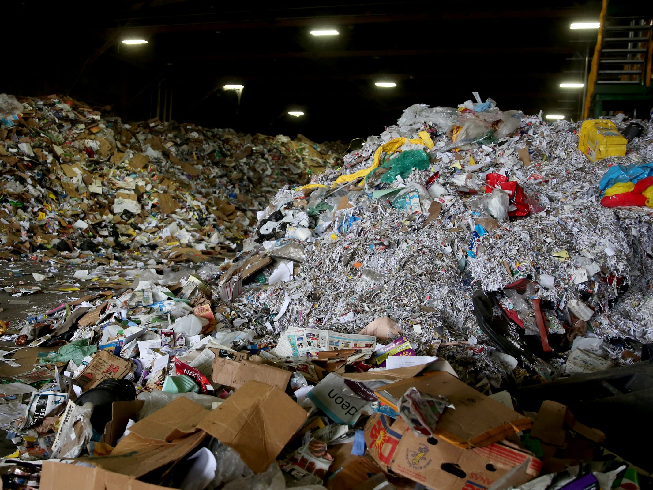 Trash that cannot be recycled or sold piles up at Garten Recycling in Salem on Friday, Aug. 3, 2018.