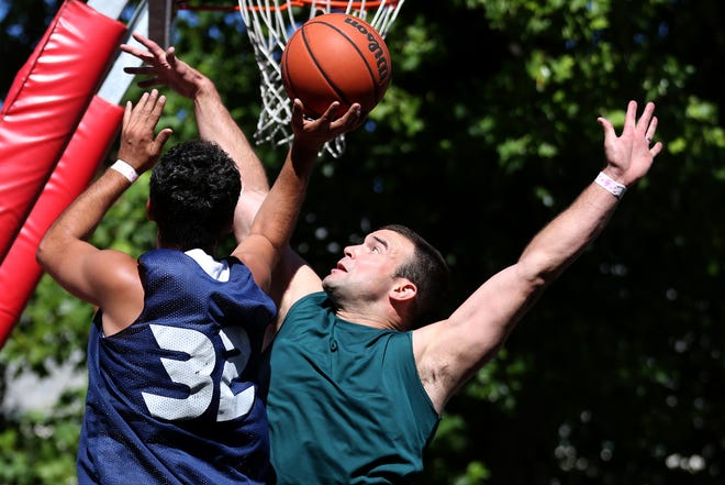 Tony Wilson, of Chafing the Dream, tries to block a shot by QQ Properties' Jacob Haqq in the Hoopla 3x3 basketball tournament near the Oregon State Capitol in Salem on Saturday, Aug. 4, 2018.