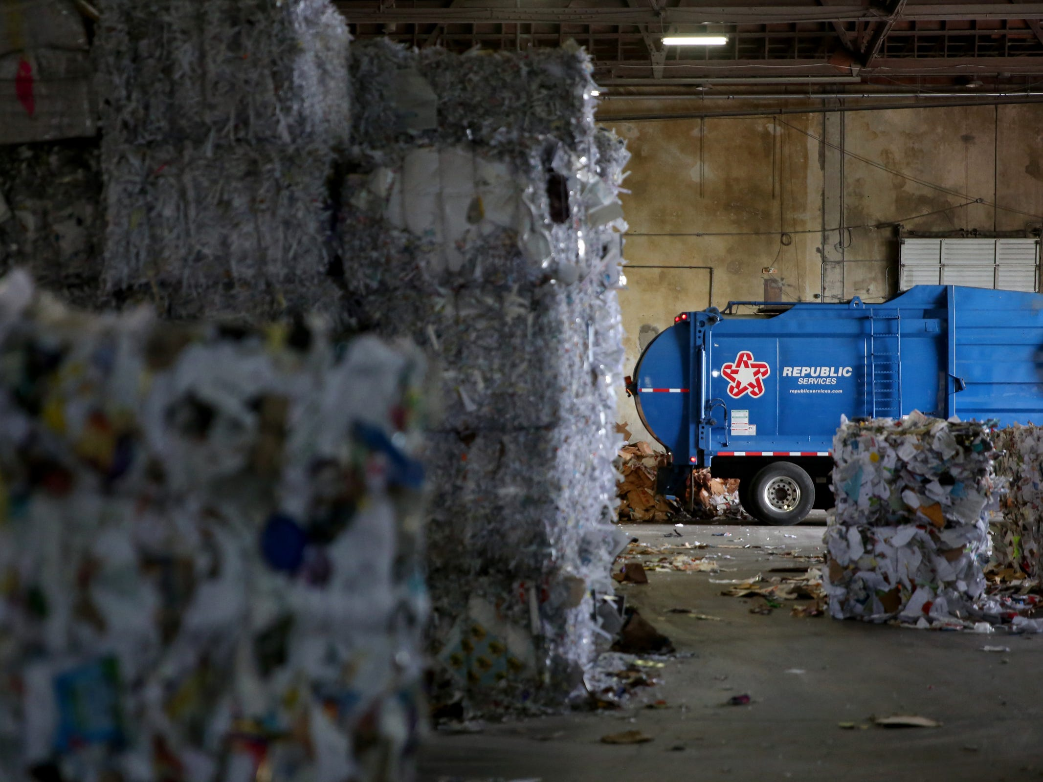 A truck empties a load of recyclables at Garten Recycling in Salem on Friday, Aug. 3, 2018.