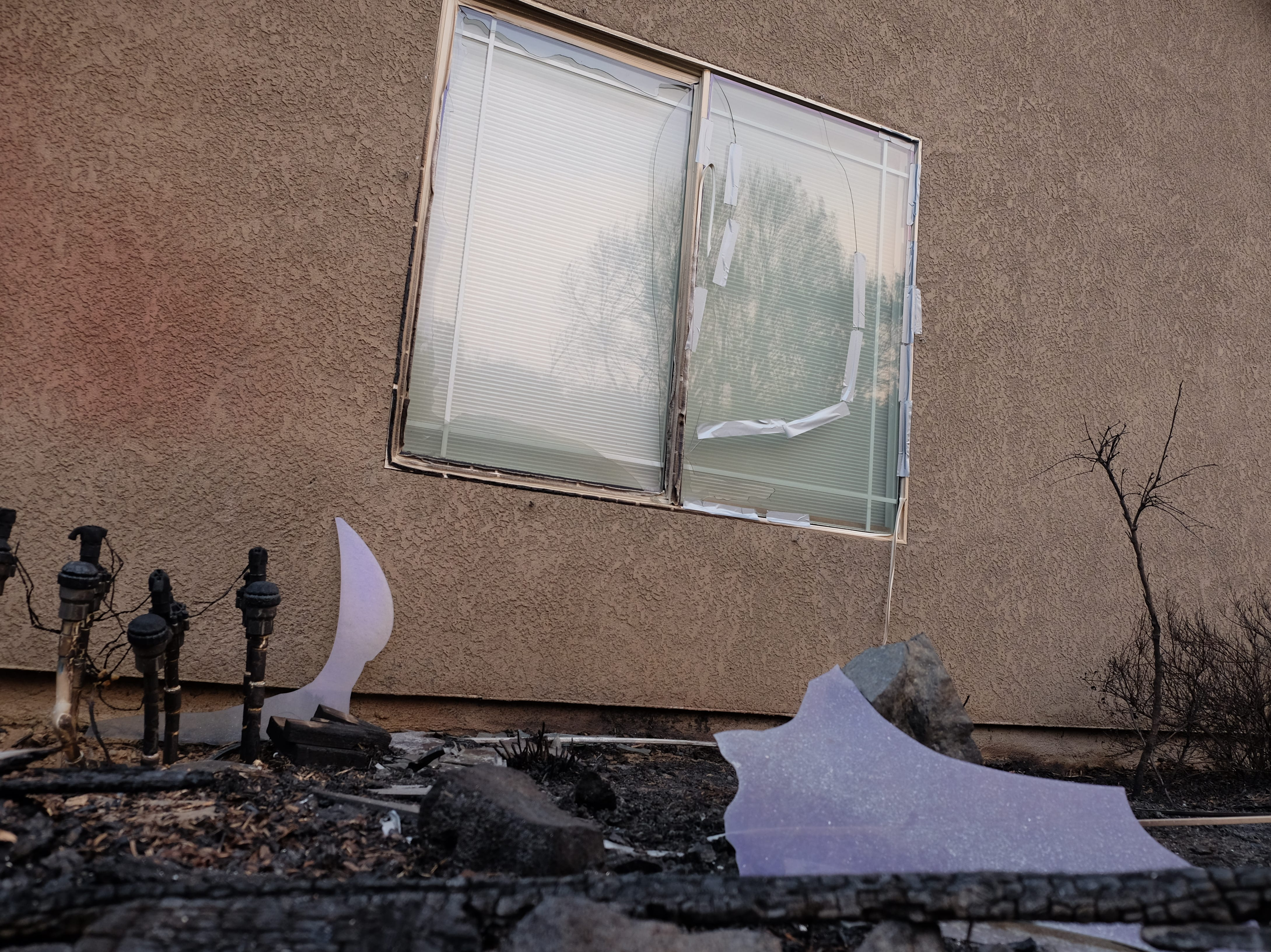 The Carr Fire burned the side yard but stopped short of the Robinson's Redding residence. A damaged window and burned utility connections were most of the damage to the home.