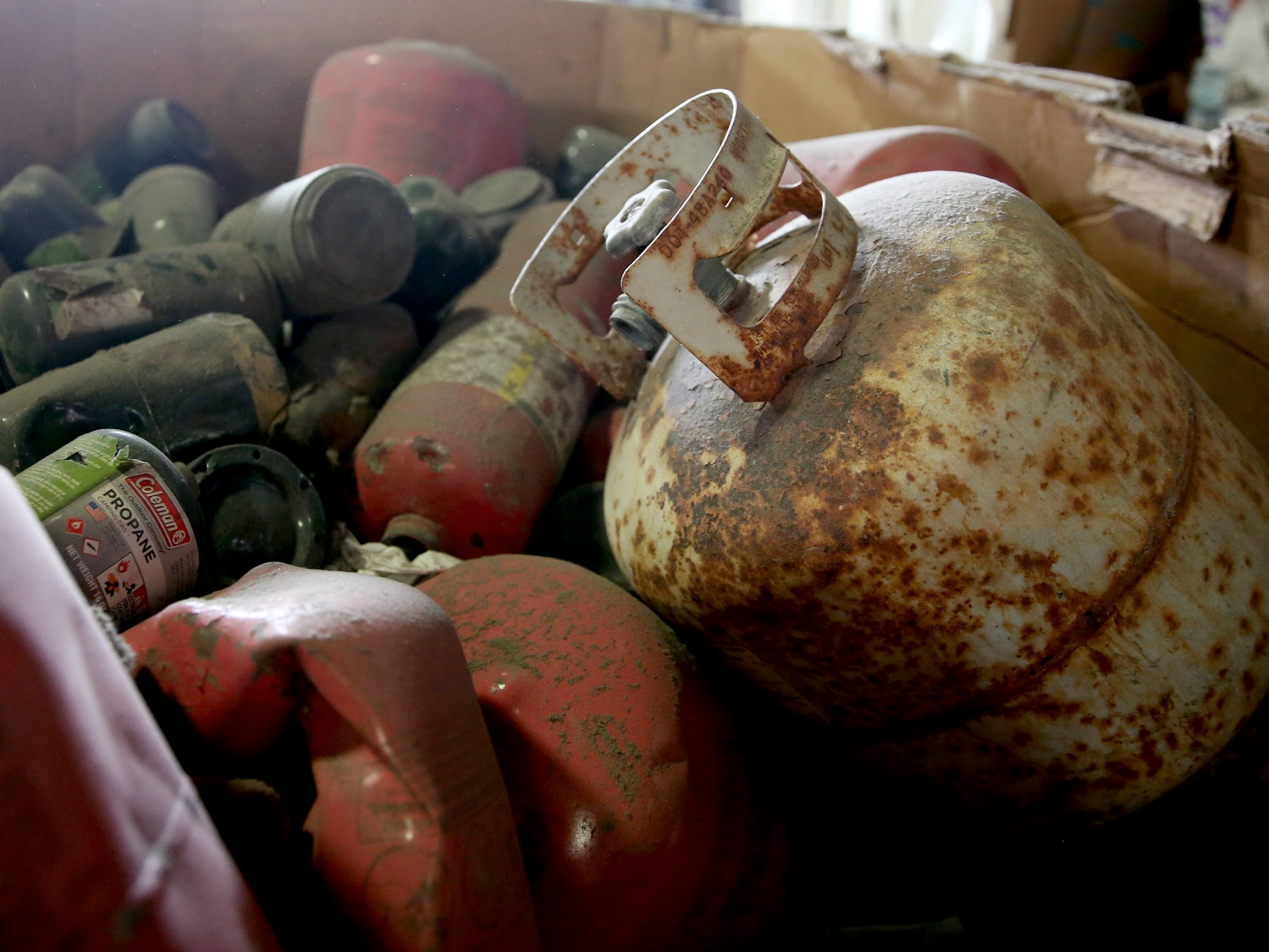 Trash that cannot be recycled or sold, like propane tanks, piles up at Garten Recycling in Salem on Friday, Aug. 3, 2018.