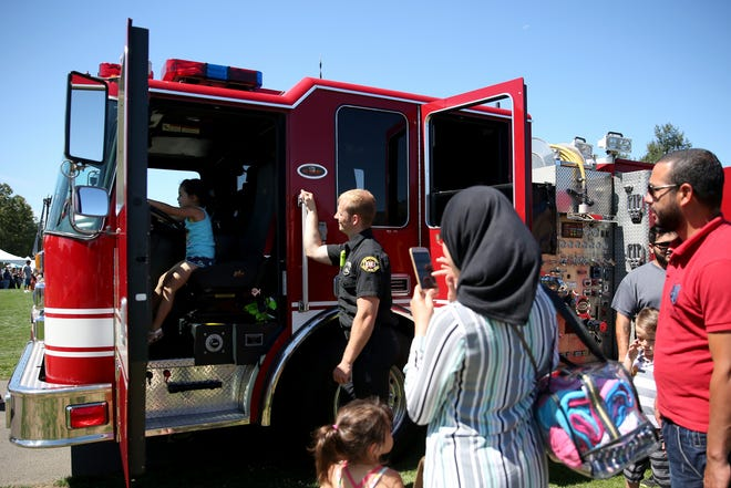 Families line-up to get a tour of a Salem Fire Department firetruck during Riverfront Family Fest at Riverfront Park in Salem on Saturday, Aug. 4, 2018.