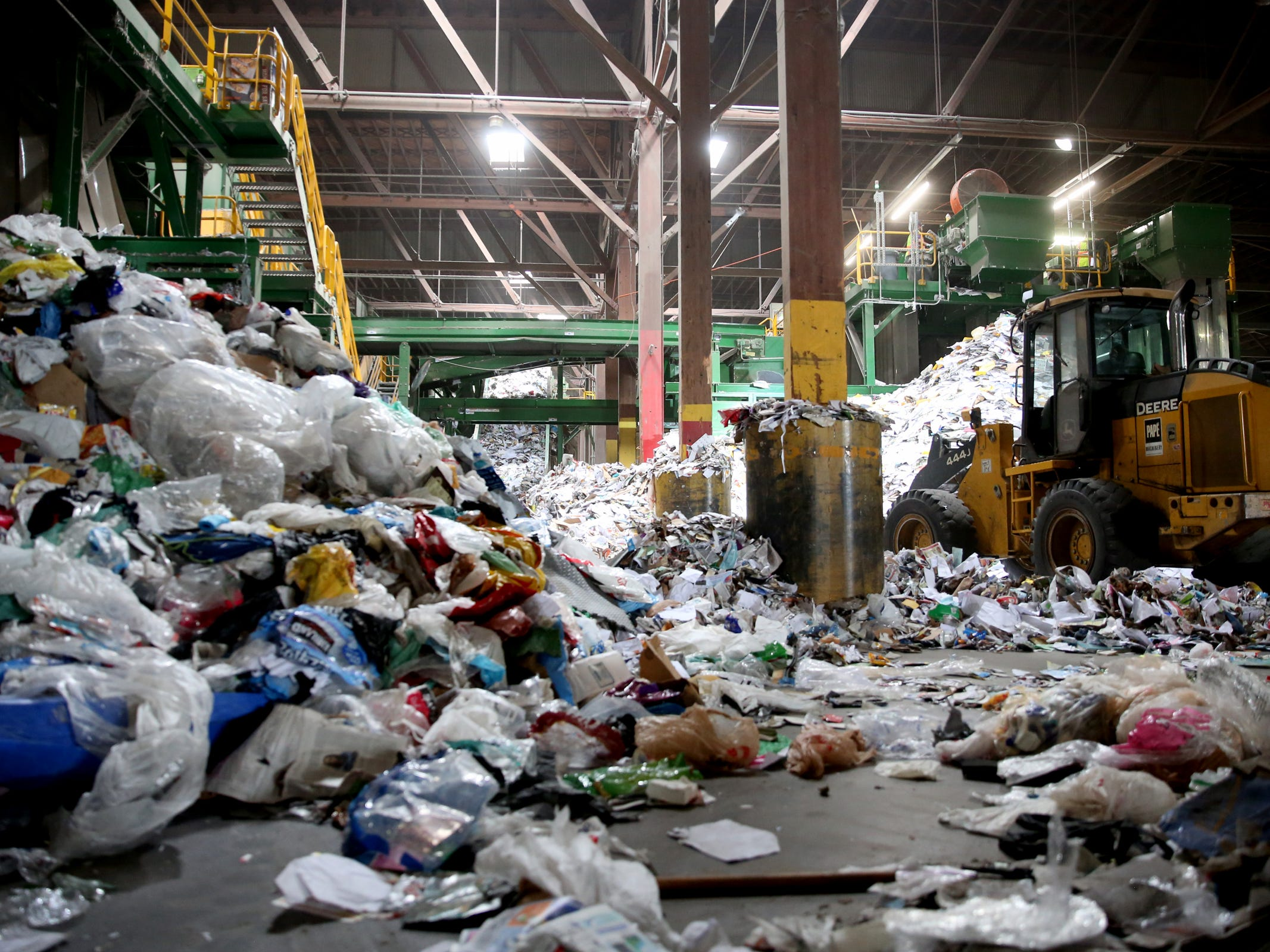 Trash that cannot be recycled or sold, like plastic bags, piles up at Garten Recycling in Salem on Friday, Aug. 3, 2018.