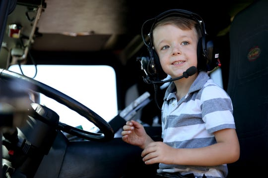 Jaiden Hearn, 5, of Salem, wears a headset and sits in the driver's seat of a Salem Fire Department firetruck during Riverfront Family Fest at Riverfront Park in Salem on Saturday, Aug. 4, 2018.