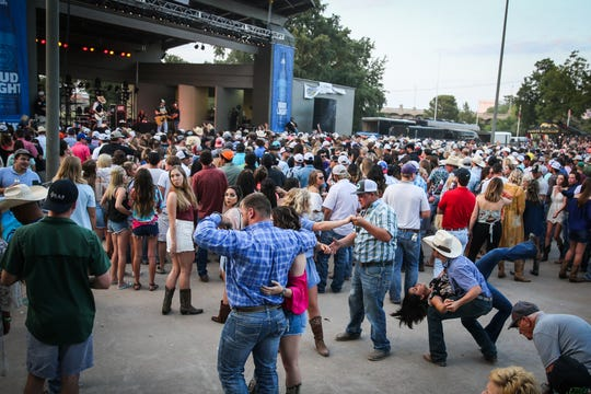 Fans dance during a concert at the Bill Aylor Sr. Memorial RiverStage.